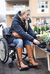 Woman in wheelchair choosing plants