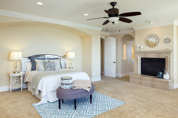 Interior of a classic style bedroom in luxury villa with fire place.