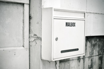 Old steel white mailbox hang on the wall
