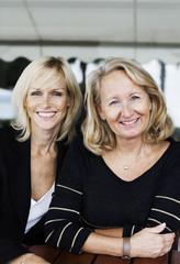 Portrait of happy businesswomen at office