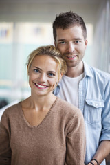 Portrait of happy young Caucasian couple standing together