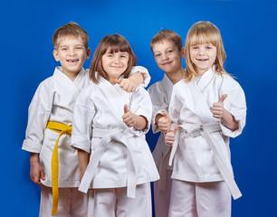 Children in karategi are showing finger super