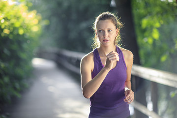 Healthy female jogging down track