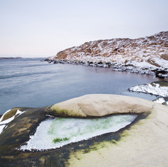 Snow covered rocks by sea during winter, West Coast, Bohuslan, Sweden