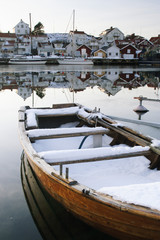 Boat covered with snow in winter