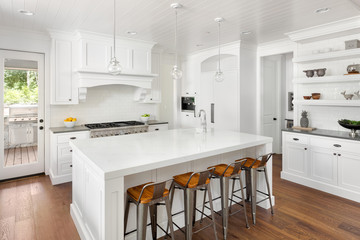 White Kitchen Interior in New Luxury Home with Hardwood Floors