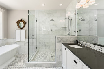 Beautiful master bathroom with shower, bathtub, and sink in new