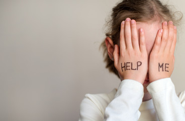 Child need help. Little girl crying. Place for your text.