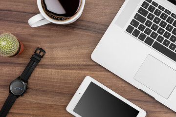 Responsive web designer desk with tablet, MacBook, coffe and watch