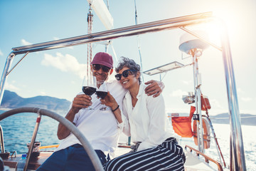 Senior couple enjoying wine on boat deck