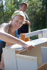 Woman mounting shelf