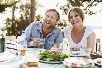Happy couple having breakfast together outdoors