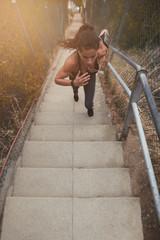 Female athlete exercising outdoors on steps