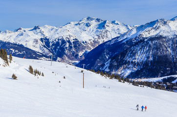 View of snow covered Courchevel slope in French Alps