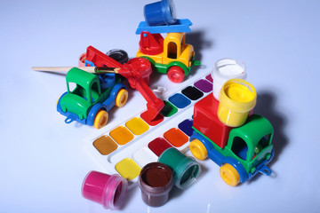 Watercolor palette with toy car