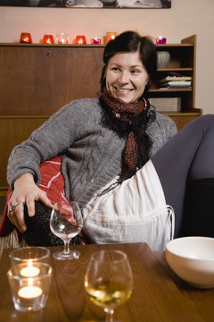 A young woman with a wineglass