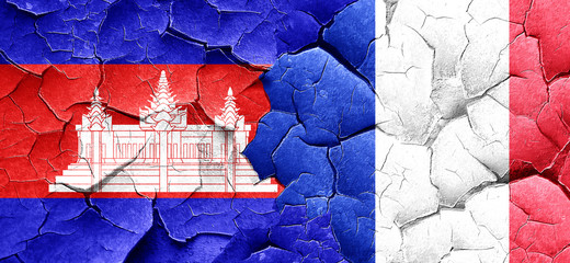 Cambodia flag with France flag on a grunge cracked wall