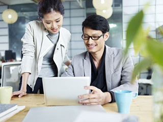 asian business man and woman working together in office