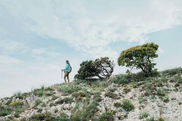 Hiker girl walking on hill