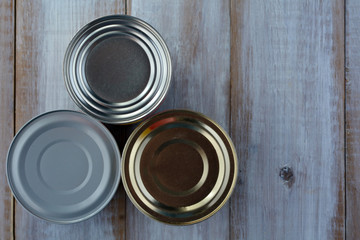 Flat lay of three tin cans in a shape of a pyramid