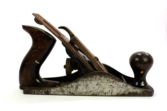 Close-up of a vintage wood plane on a white background