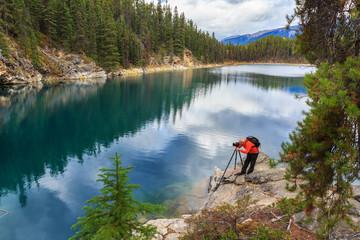 Photographer in Horseshoe Lake in Jasper National Park, Alberta, Canada
