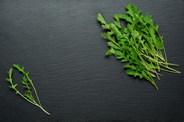 Fresh juicy arugula on a black background