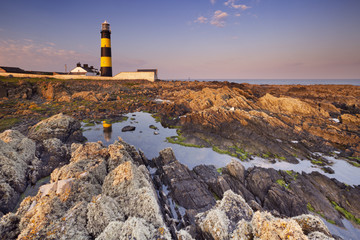 Lighthouse in Northern Ireland at sunset