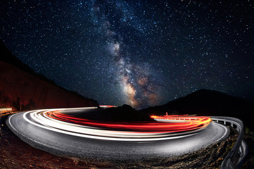 Stars and cars lights trails in the road Fotomurales