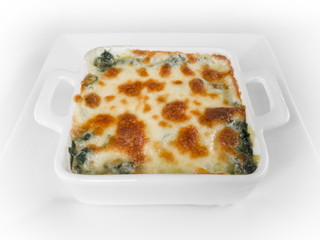 Baked spinach and cheese on the white background.