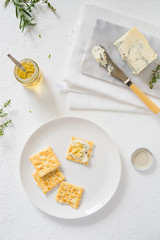 Crackers with gorgonzola and herb and white sweet wine  jelly