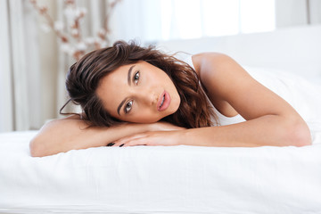 Close-up portrait of aa beautiful young woman in bed
