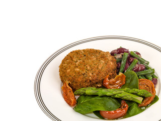 Veggie Burger with Asparagus and Salad Isolated Against a White Background With Copy Space