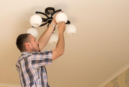 Man installing  bulb