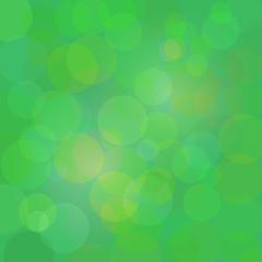 Green abstract circle lights vector bokeh background.