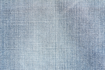 Closeup denim jeans texture. Stitched textured blue denim jeans background. Old grunge vintage denim jeans. Denim jeans fashion design. Dark edged.
