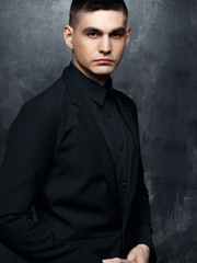 Portrait of handsome man in a black suit.