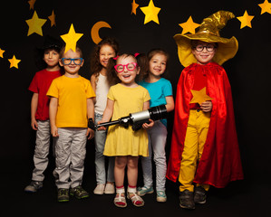 Six kids in stargazers costumes with telescope