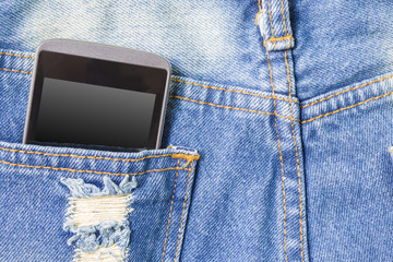 Mobile phone in the back pocket of blue jeans with copyspace mac
