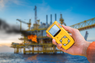 Safety concept of fire in oil and gas, petrochemical industry, gas detector checking gas leaking before working to prevent fire case.