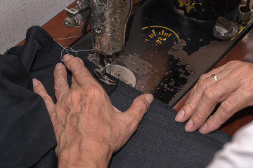 Tailor using industrial sewing machine