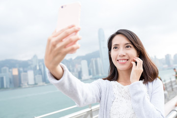 Woman taking selfie image by mobile phone