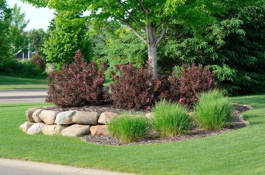 Landscaping with Weigela Shrubs and Rock Retaining Wall