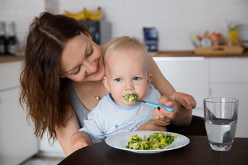 Mother and child eating together and have fun