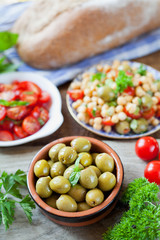 Mediterranean salad board - cherry tomatoes, green olives, chick