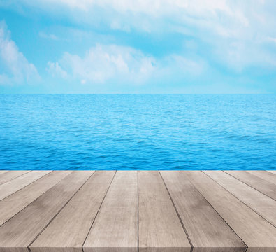 Wood table top on blue sea and sky background