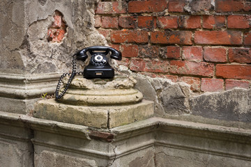 Old phone on a dilapidated wall