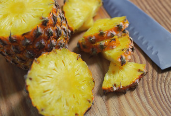 slices pineapple cut knife
