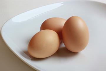 3 eggs closeup on white plate - good choice on breakfast