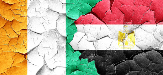 Ivory coast flag with egypt flag on a grunge cracked wall